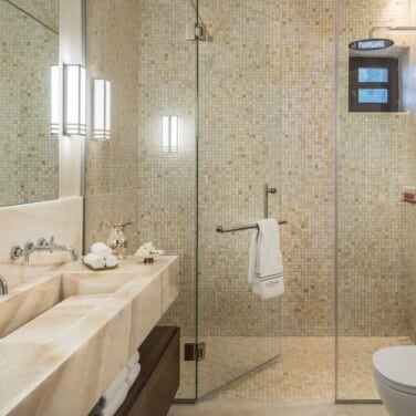 Executive Suite_Leoncini Mansion (the Heritage Building) Onyx Marble with Mosaics Shower